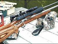 The Savage Model 12 Varmint (foreground), mounting a 6.5-20X Full Field II Burris, and the Ruger Model 77 Mark II Target, sporting a 36X Leupold, look like twins with their laminated stocks.