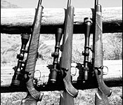 From left: Anschutz Model 1710 D with Kahles 2-7x36mm rimfire scope, Kimber 22 Classic with Burris 3-9X Fullfield II, Cooper 57-M Custom Classic with Leupold Vari-X III 6.5-10x40mm.