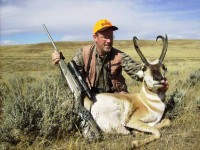 hunter with pronghorn and .25-06 rifle
