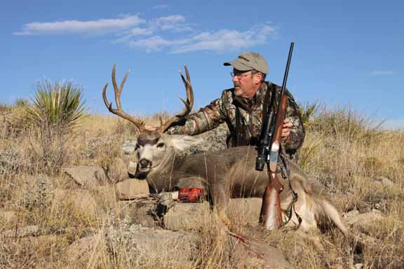 author with mule deer and Ruger No. 1 in 6.5 creedmoor