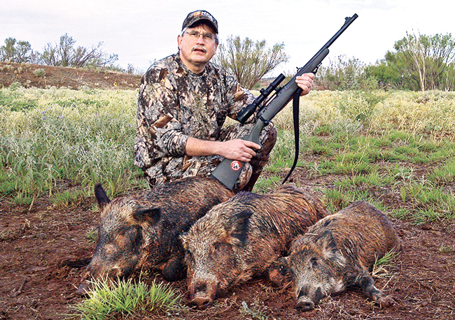 The West Texas hog ran across a grassy field and headed for the tree line, crossing right to left,