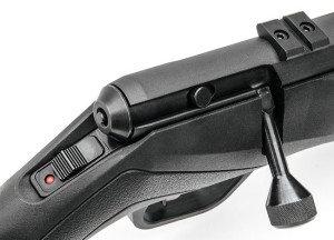 You can tell the gun's condition by looking at either the rear cap of the bolt or the position of the cocking cam. The B Series features a sensible sliding tang safety.