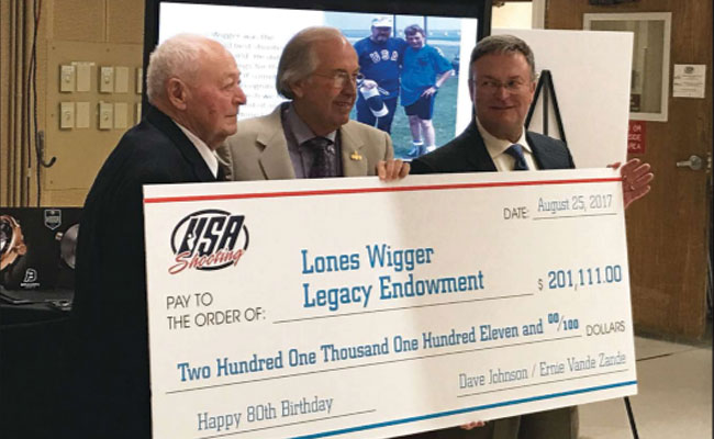 Wigger with former teammate and endowment funding maestro Ernie Vande Zande (c.) and USA Shooting interim CEO Dave Johnson. The Lones Wigger Legacy Endowment will help support our Junior Olympic shooting program.