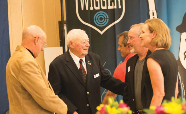 Lones W. Wigger, Jr. (c.) says hello to RifleShooter editor Scott Rupp at Wigger's 80th birthday celebration as his daughter, Deena, looks on. The event drew hundreds of family, friends and teammates to honor the United States' greatest shooting champion.