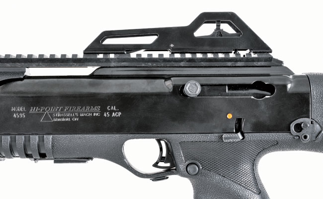 The carbine features a bolt that locks back on the last round and a simple manual safety. The magazine release is located behind the trigger guard.