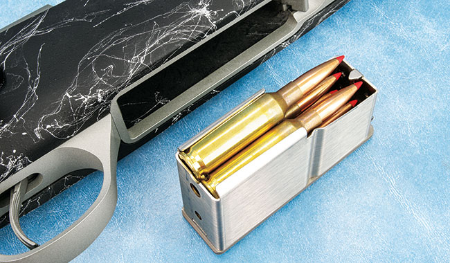 The Fury's detachable box magazine can be top-loaded and holds four standard rounds or three magnums. It fits totally flush with the bottom of the receiver.