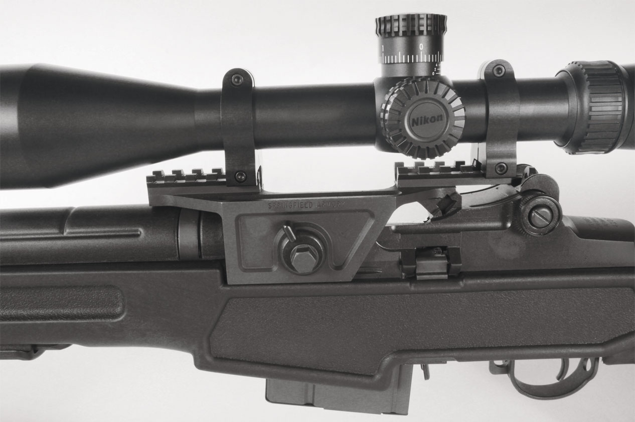 A long-range rifle like this calls for a scope, and Springfield's M1A optional steel scope mount is well designed and sturdy—attaching at three points.