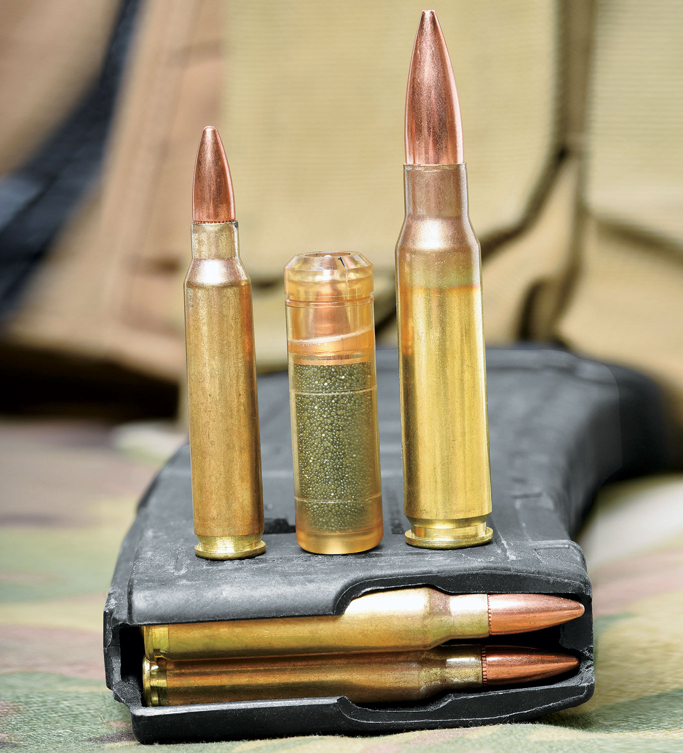 While cased telescoped ammo (c.) offers a number of benefits compared to metallic cartridges, its chief attribute is a substantial reduction in weight, approximately 40 percent.