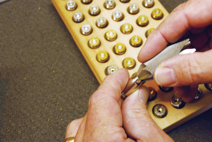 The Art Of Reloading Pistol Cartridges.
