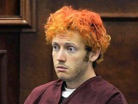 Colorado shooting suspect James Eagan Holmes makes his first court appearance in Aurora