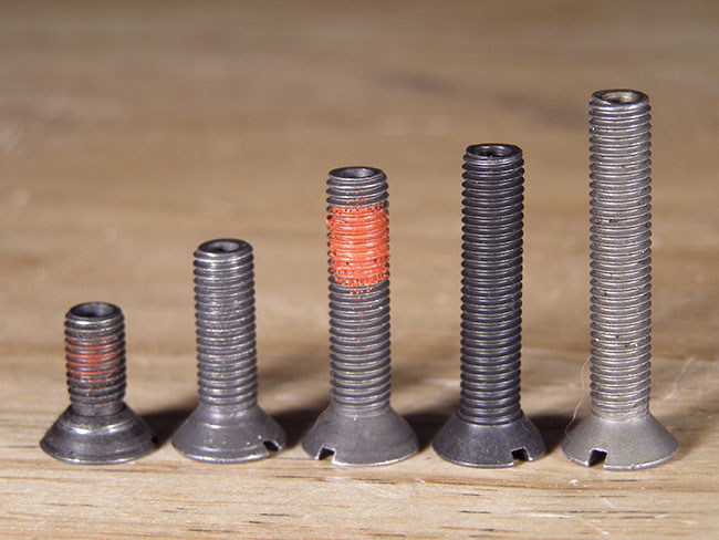 Buttstock screws are supplied in a bewildering variety of lengths. Too short and it won't engage the threads. Too long and it will extend into the buffer tube.