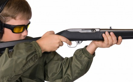 Kid_with_Ruger_10-22_F