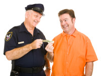 Policeman Accepts Bribe