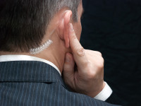 Secret Service Agent Listens To Earpiece, Shoulder
