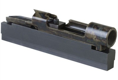 This fixture holds Mauser receivers and barreled actions in a bench vise, drill press or milling
