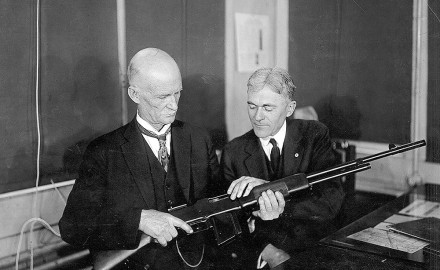 John Moses Browning and a Winchester official examine an early production Browning Automatic