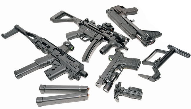 Four choices for a compact  PDW suitable for discreet carry: Micro Roni, MP5K-PDW clone,  Glock 19 with stock and vertical grip and a Kel-Tec SUB2000.