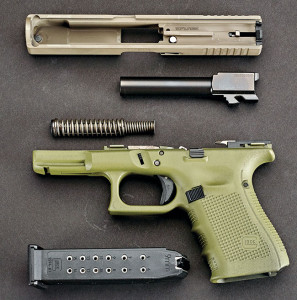 """When taking apart a Gen 4 Glock, the only difference the average user will note is the beefed-up recoil system. Note also it's marked """"USA"""" on the slide."""