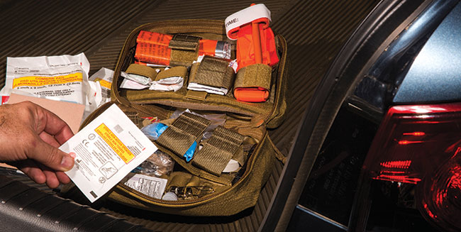 Along with a firearm you should consider storing a good trauma kit in your vehicle, just in case. The life it might save could be your own. Photo by Alfredo Rico.