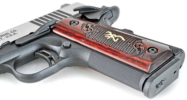 The checkering on the Browning's composite polymer frame isn't very aggressive, but it doesn't need to be.  The rosewood grips are beautiful from any angle.