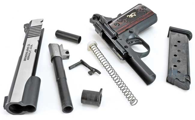 The tilting barrel has more of a Browning Hi-Power linkage than the original 1911's swinging link, but otherwise these parts should be very familiar to anyone who has ever taken apart an original 1911.