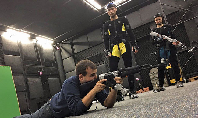 Part of the motion capture process for PlayerUnknown's Battlegrounds. Proper prone position with an AK is demonstrated to two actors in motion capture gear.