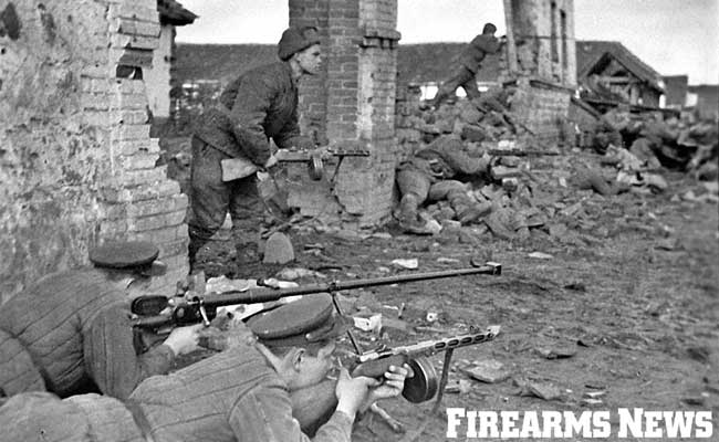 Red Army soldiers equipped with PPSh-41 submachine guns provide protection for a 14.5mm Anti-Tank Rifle on the Eastern Front.