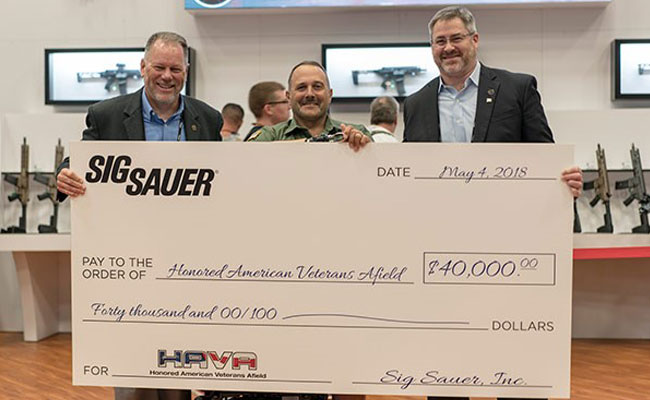 Pictured left to right: HAVA Chairman and CEO Tom Taylor, HAVA Learn to Shoot Again Director Rick Cicero, SIG SAUER Electro-Optics President Andy York