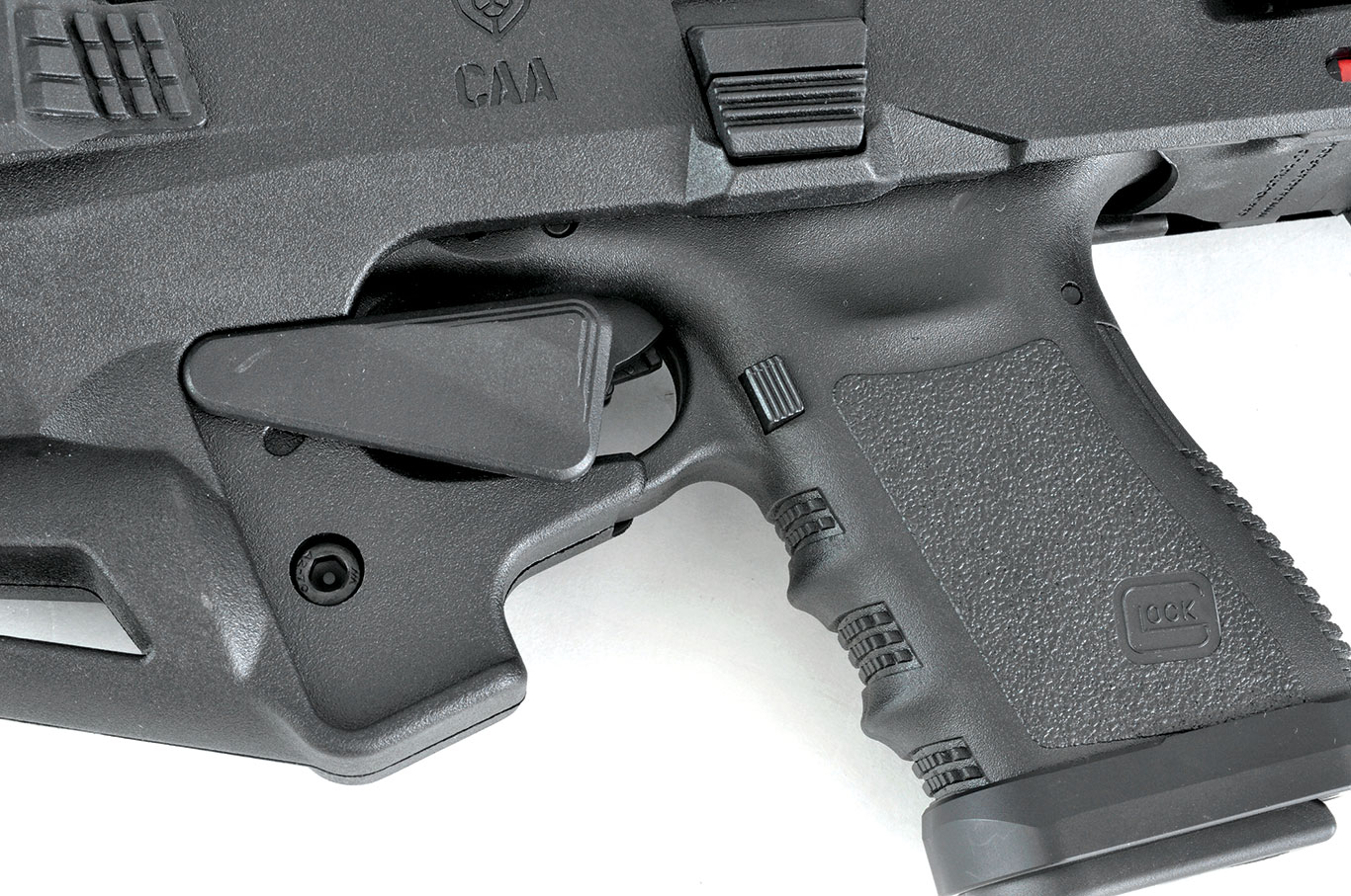 Micro RONI Stabilizer with Glock inserted, showing the manual safety lever up and blocking access to the trigger guard.