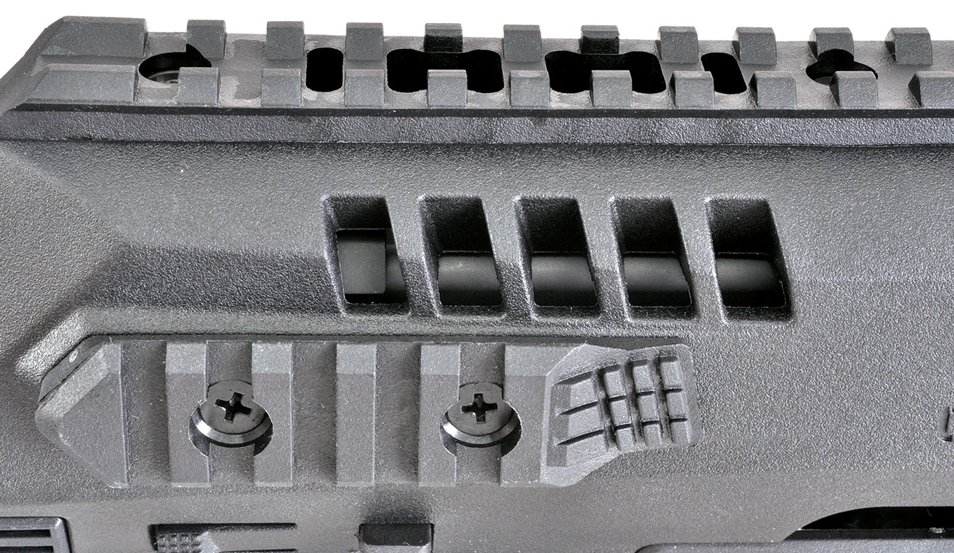 There are five vent slots on either side of the RONI chassis for cooling.  Inside the left-most slot, you can see the rear of the aluminum barrel shroud where it covers the end of the Glock slide.