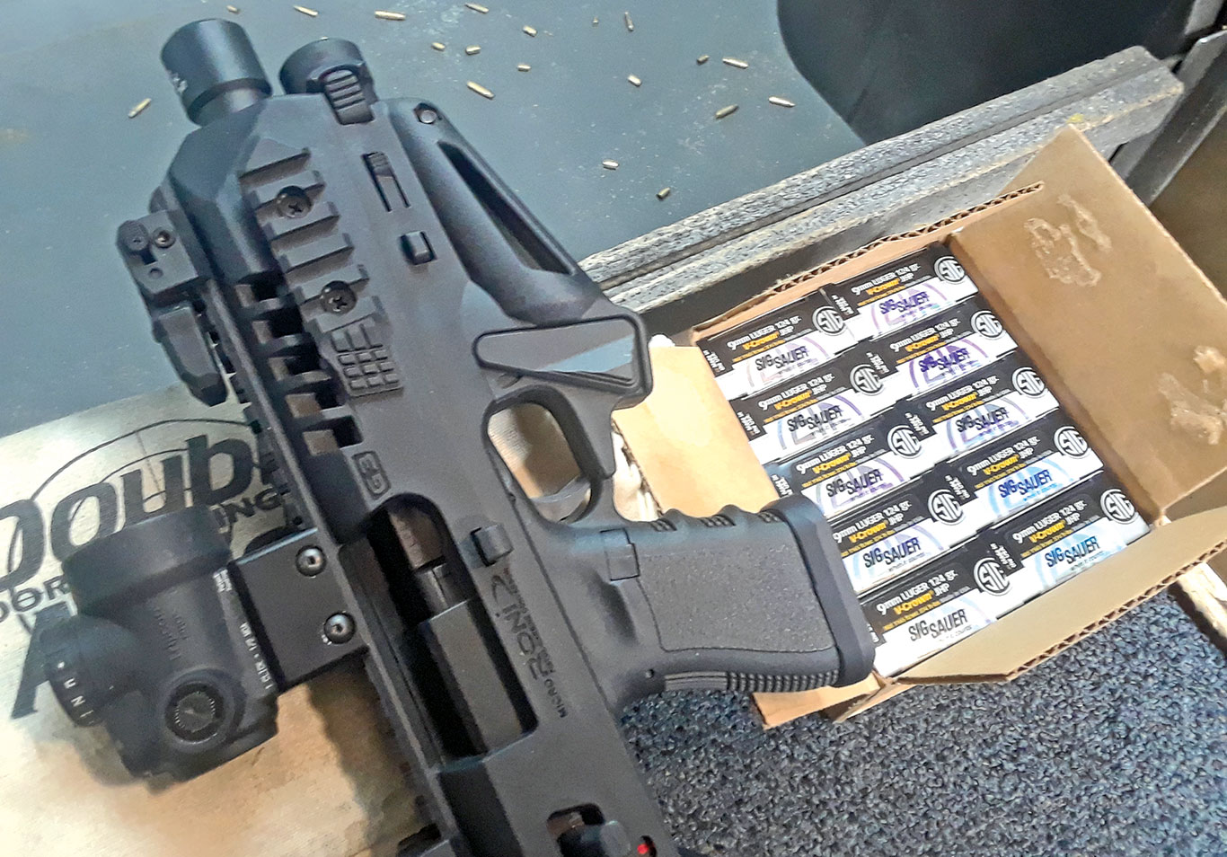 When zeroing the RONI at the 50-yard indoor range, Tarr used SIG Elite 124-grain JHPs. A short pistol mag made it easier to shoot off sandbags.
