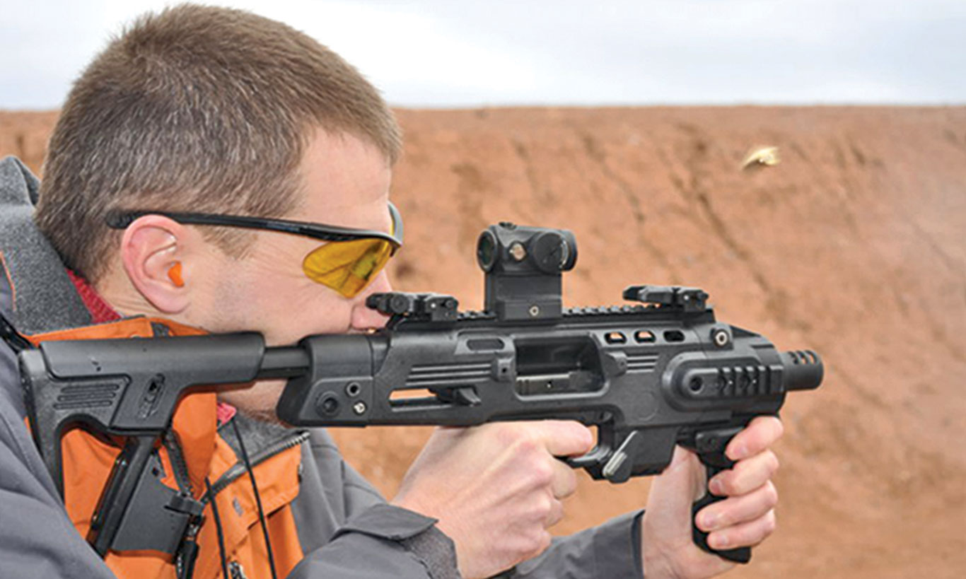 Tarr shooting an original full-size RONI in 2010, not long after they were introduced.  The Micro RONI is smaller and lighter, and the Micro RONI Stabilizer does not require registering your Glock as an SBR.