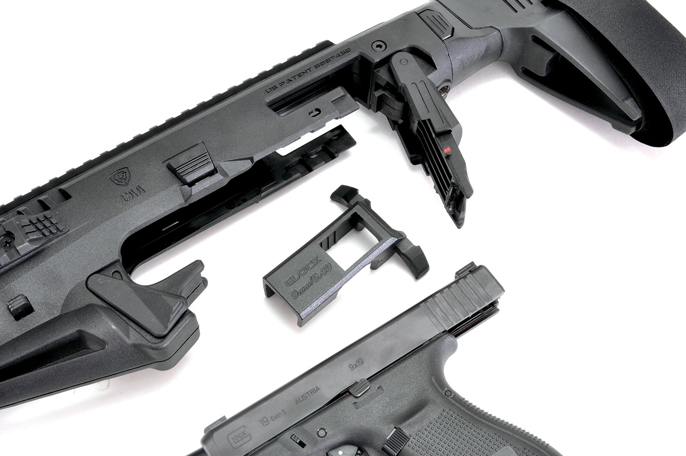 The T-shaped charging handle fits over the  top of the Glock slide, and it is inserted in  the RONI's receiver  once you lower the  gate. Tarr learned the Micro RONI works with Gen 3 and 4 Glocks, but not the new Gen 5.
