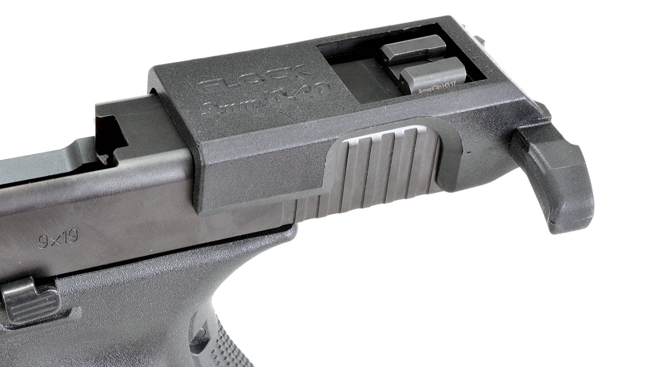 The Glock slide with the charging handle installed.  Once the Glock is inside the RONI housing, the charging handle has no room to come off.