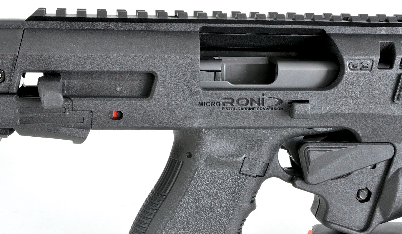 With the slide of the Glock locked back, it's even easier to see just how much room the engineers have given ejecting brass so they don't hang up on the RONI receiver.