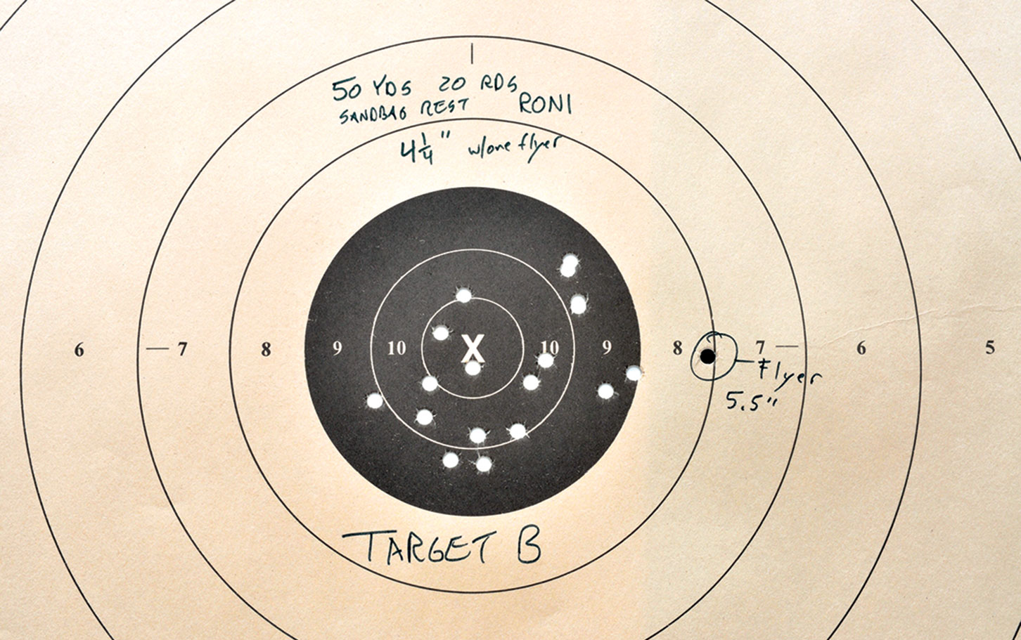Target B:  If you excuse the one flyer, Tarr shot a 4.25-inch 20-shot group at 50 yards shooting the  Micro RONI Stabilizer off sandbags. That is far more accurate shooting than he can accomplish just using a Glock 19.