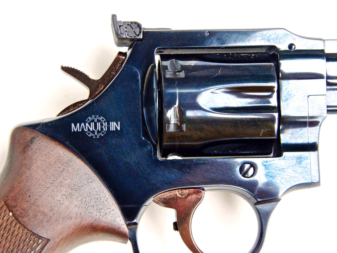 "View of the windage adjustment screw on the MR73's sights; also visible are the Manurhin logo and the ""Made in France"" marking."