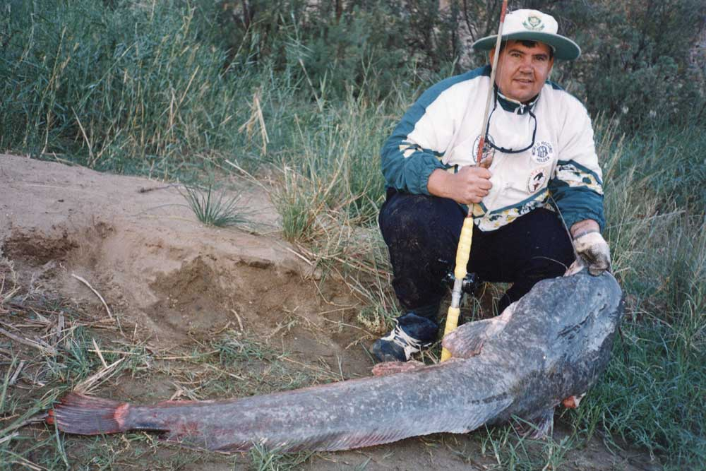 //www.gameandfishmag.com/files/10-biggest-catfish-world-records-of-all-time/sharptooth_world-record.jpg