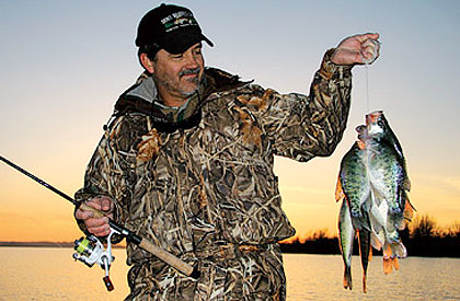 The period of the spring spawn isn't the only time for loading up on crappie. Here's a look at the action available while the fish are staging to move shallow.  (February 2009)