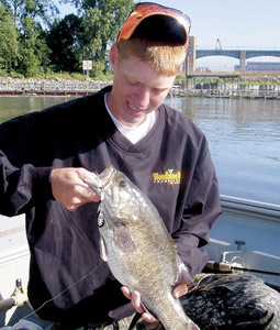 The big smallmouth bass that you can catch on the Mississippi's big water will put a big smile on your face. (August 2007)