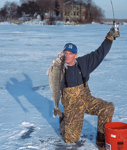 This expert has drawn an analogy between pregnancy and the pitter-patter of little fins slapping on the ice. You can tell he's pumped up and ready to take on the responsibility of another hardwater season! (January 2007)