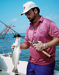 Here's where you can catch speckled trout and redfish from the same waters on our Texas Coast. (May 2006)