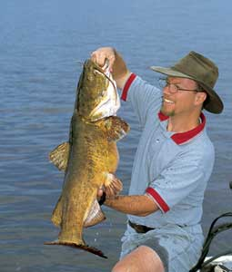 You'll catch your share of chunky channel catfish and fat flatheads when you dunk your offering into any of these first-rate rivers or lakes.  (June 2007)