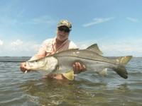 Mark Nichols displays the kind of snook that can be taken from the beaches in the summer months. Photo courtesy of DOA Lures.
