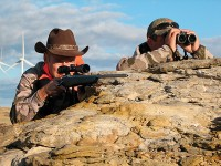 Gary Lewis rests his Kimber while Scott Denny, of Cheyenne, glasses from a rock outcropping on an October hunt in Wyoming. Photo by Gary Lewis.