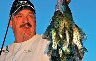 Rick Dykstra admires a stringer of spring specks. The flesh of spring crappies is white, firm and delicious.  Photo by Mike Gnatkowski.