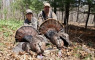The author, right, and his mother pose with a pair of dandy gobblers they killed on opening day in the Ozarks. Photo by Tony Kalna Jr.