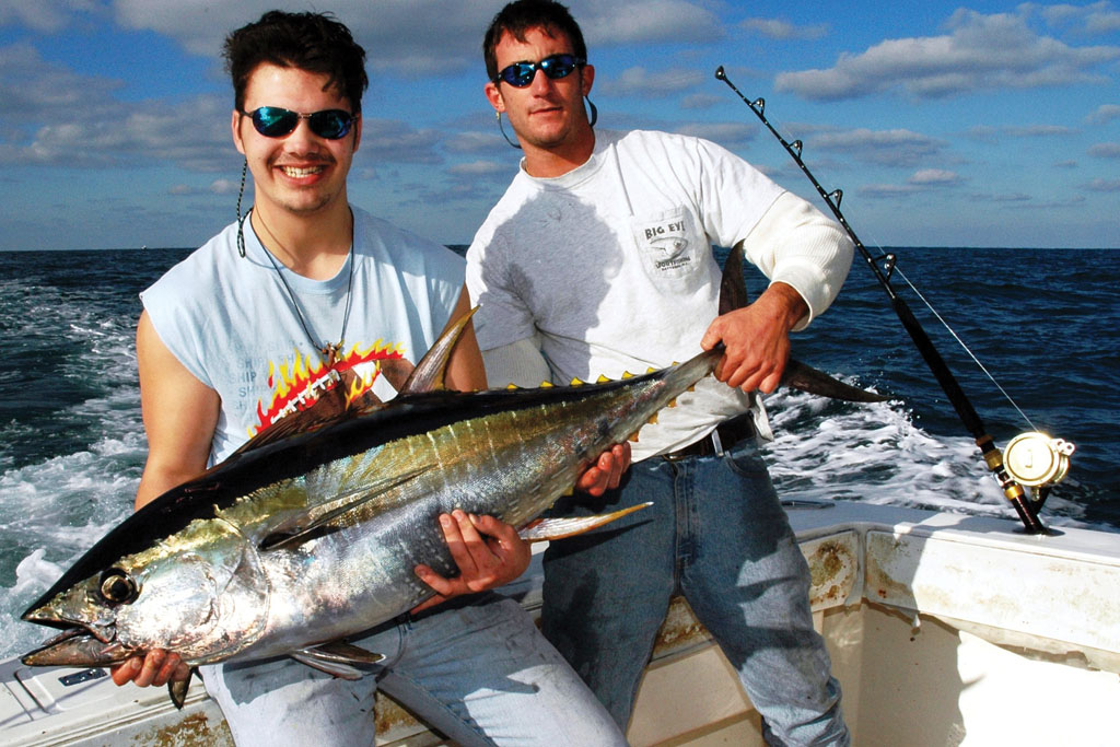 Daniel Felsher and Bobby Adisano are holding the yellowfin tuna boated by Felsher while fishing the Midnight Lump. Photo by John N. Felsher.