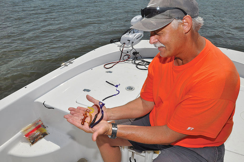 Big soft plastic baits are the ticket for enticing big largemouth bass in heavy cover. Photo by Mike Marsh.