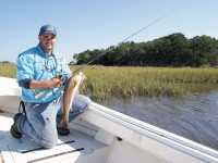 Capt. Jimbo Keith finds plenty of summertime redfish around the outer islands at Cedar Key. Photo by Bud Reiter.